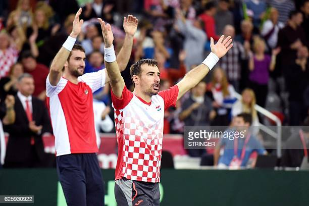 Croatia's tennis players Ivan Dodig and Marin Cilic celebrate after winning the Davis Cup World Group final doubles match between Croatia and...
