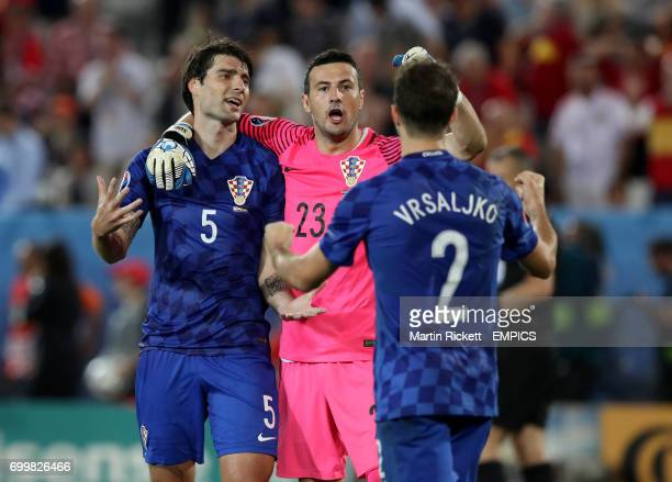Croatia's Vedran Corluka goalkeeper Danijel Subasic and Sime Vrsaljko celebrate after the final whistle