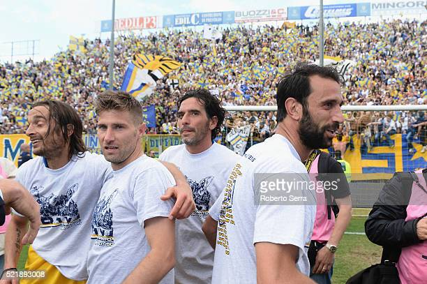 Crocefisso Miglietta and Riccardo Mussetti and Alessandro lucarelli and Luca Cacioli of Parma celebrate after the Serie D match between Parma Calcio...