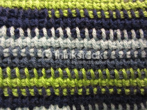 Crocheted Afghan Stitch Pattern In Multiple Colors Closeup Stock