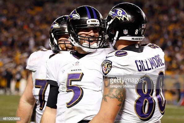 Crockett Gillmore celebrates a fourth quarter touchdown with Joe Flacco of the Baltimore Ravens against the Pittsburgh Steelers during their AFC Wild...
