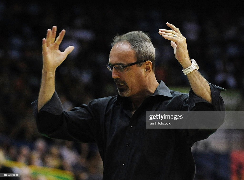 Crocodiles coach Paul Woolpert gestures during the round 17 NBL match between the Townsville Crodcodiles and the Sydney Kings at Townsville Entertainment Centre on February 2, 2013 in Townsville, Australia.