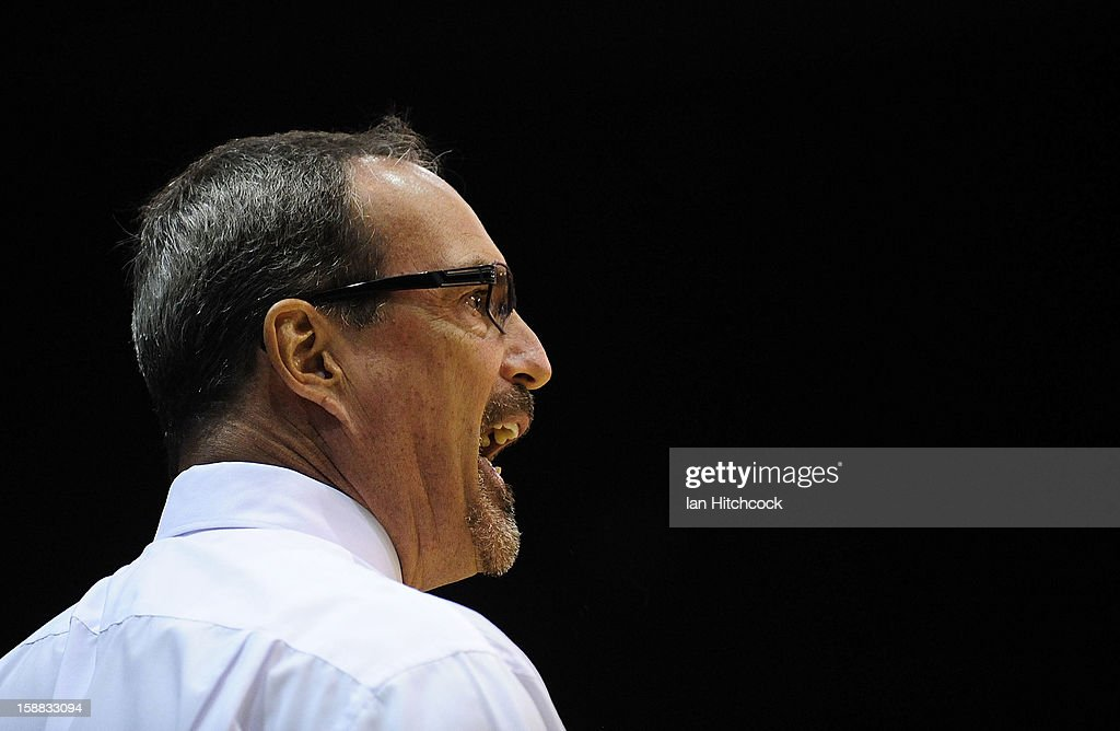 Crocodiles coach Paul Woolpert yells out during the round 12 NBL match between the Townsville Crocodiles and the Adelaide 36ers at Townsville Entertainment Centre on December 31, 2012 in Townsville, Australia.