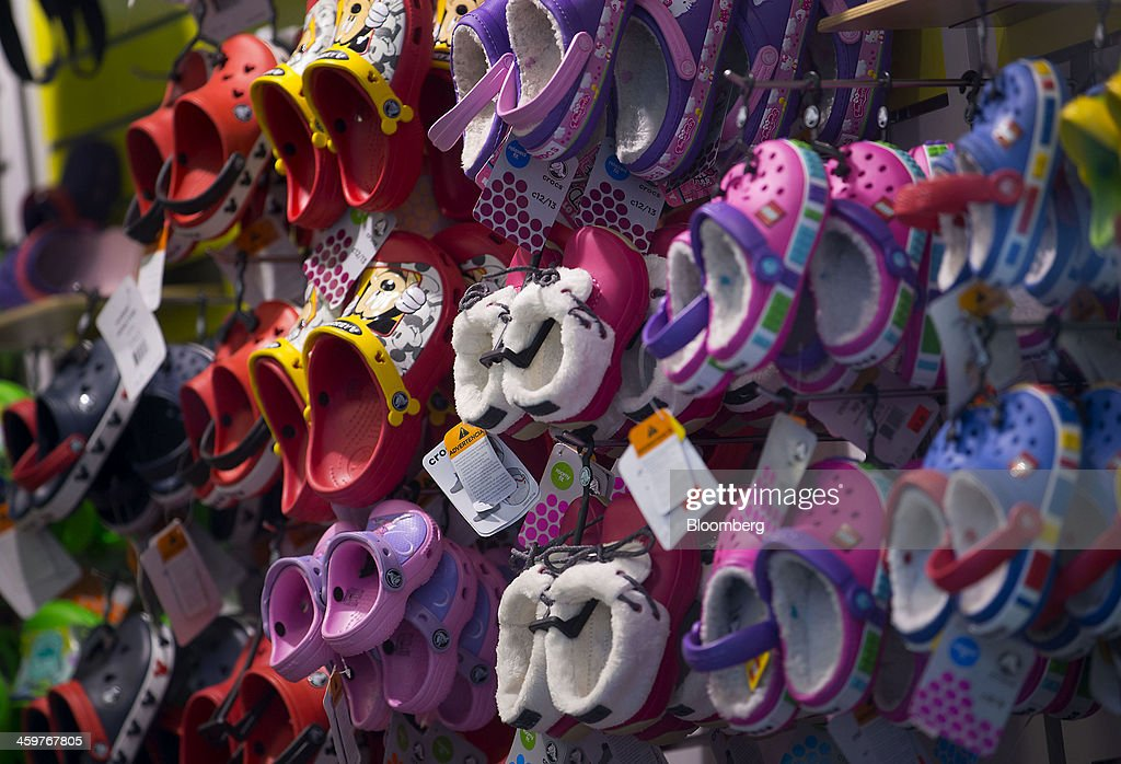 Crocs Inc. shoes are displayed for sale at a store in New York, U.S., on Monday, Dec. 30, 2013. Crocs Inc. rose as much as 14 percent in early trading after saying Chief Executive Officer John McCarvel will retire and Blackstone Group LP will invest $200 million in the maker of colorful plastic clogs. Photographer: Jin Lee/Bloomberg via Getty Images