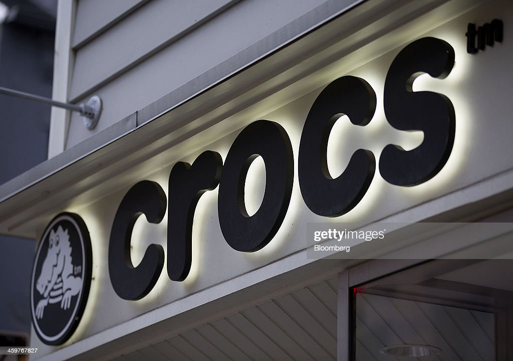 Crocs Inc. signage is displayed outside of a store in New York, U.S., on Monday, Dec. 30, 2013. Crocs Inc. rose as much as 14 percent in early trading after saying Chief Executive Officer John McCarvel will retire and Blackstone Group LP will invest $200 million in the maker of colorful plastic clogs. Photographer: Jin Lee/Bloomberg via Getty Images