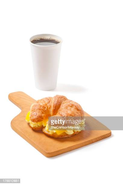 Croissant Breakfast Sandwich with Egg, Cheese, and Coffee