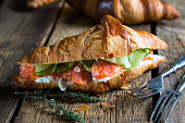 Croissant sandwich with salmon and cream cheese