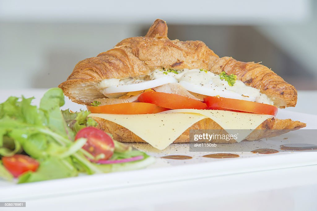Croissant with cheese tomato chicken and salad : Stock Photo