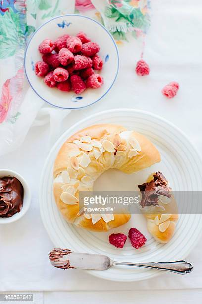 Croissant with chocolate and raspberries