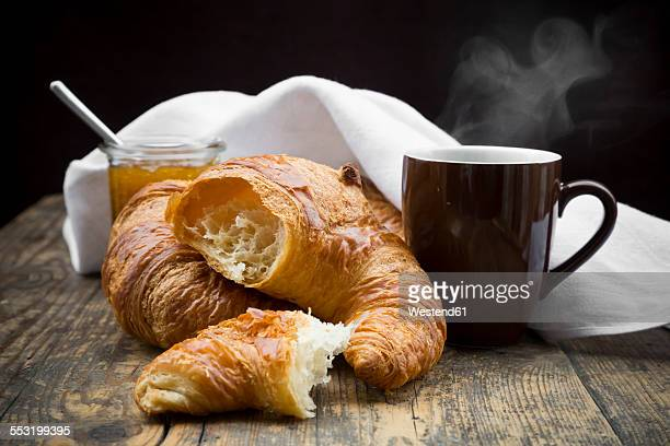 Croissants, fig jam and cup of hot coffee