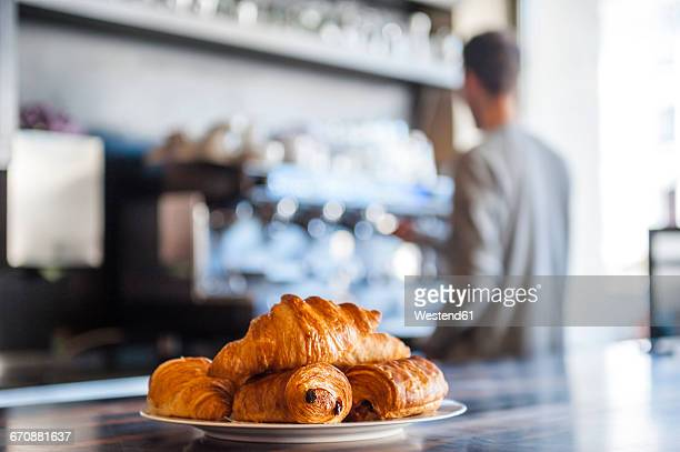 Croissants on plate on counter of a cafe