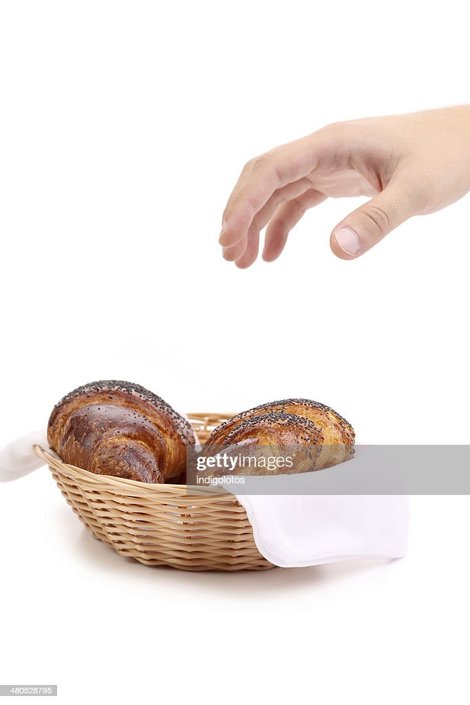Croissants with poppy in basket. : Stock Photo