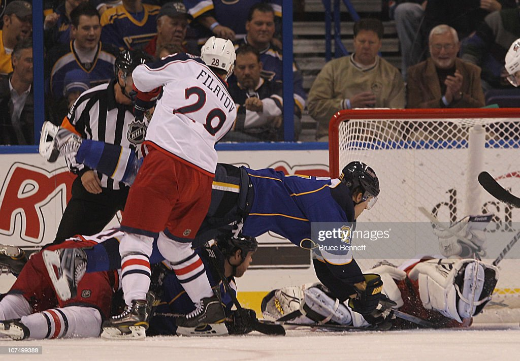 BJ Crombeen #26 of the St. Louis Blues is dumped by <a gi-track='captionPersonalityLinkClicked' href=/galleries/search?phrase=Nikita+Filatov&family=editorial&specificpeople=4250147 ng-click='$event.stopPropagation()'>Nikita Filatov</a> #28 of the Columbus Blue Jackets at the Scottrade Center on December 9, 2010 in St Louis, Missouri.