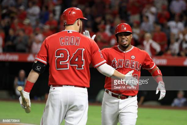 J Cron congratulates Luis Valbuena of the Los Angeles Angels of Anaheim after his tworun homerun during the first inning of a game against the...