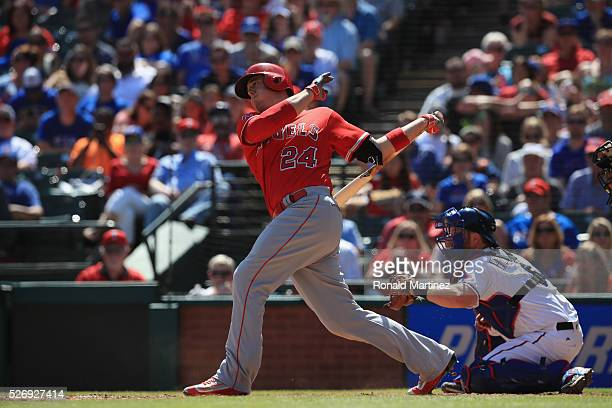 J Cron of the Los Angeles Angels hits a tworun single against the Texas Rangers in the fifth inning at Globe Life Park in Arlington on May 1 2016 in...