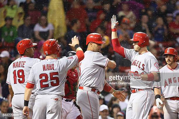 J Cron of the Los Angeles Angels of Anaheim after hitting a grand slam in the sixth inning during the game against the Boston Red Sox at Fenway Park...