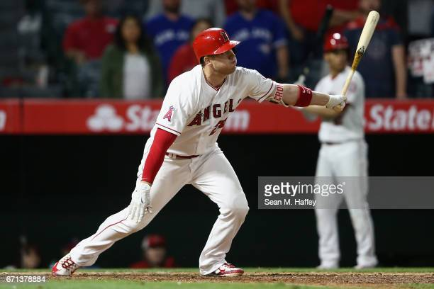 J Cron of the Los Angeles Angels of Anaheim flys out to centerfield during the thirteenth inning to end a game against the Toronto Blue Jays 87 at...