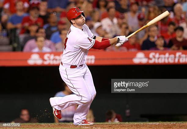 J Cron of the Los Angeles Angels of Anaheim folows through as he hits a solo home run to give the Angels a 21 lead in the seventh inning against the...