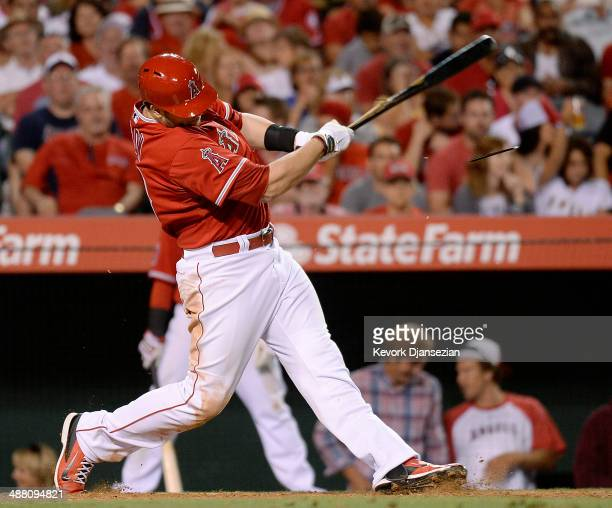 J Cron of the Los Angeles Angels of Anaheim hits a base hit to score teammate Howie Kendrick ##47 against Texas Rangers in the sixth inning at Angel...