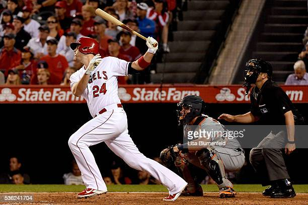 J Cron of the Los Angeles Angels of Anaheim hits a RBI sacrifice in the fourth inning against the Detroit Tigers at Angel Stadium of Anaheim on May...