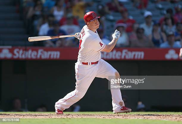 J Cron of the Los Angeles Angels of Anaheim hits a sacrifice fly to bring in Mike Trout in the seventh inning against the Toronto Blue Jays at Angel...