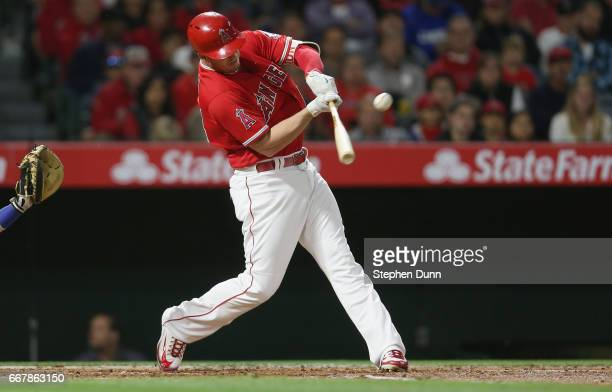 J Cron of the Los Angeles Angels of Anaheim hits a sacrifice fly to drive in the Angels' first run in the second inning against the Texas Rangers at...