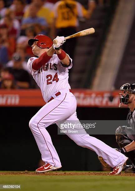 J Cron of the Los Angeles Angels of Anaheim hits a solo home run during the seventh inning of the game against the Chicago White Sox at Angel Stadium...