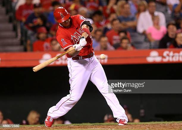 J Cron of the Los Angeles Angels of Anaheim hits a two run double in the seventh inning against the Texas Rangers at Angel Stadium of Anaheim on...