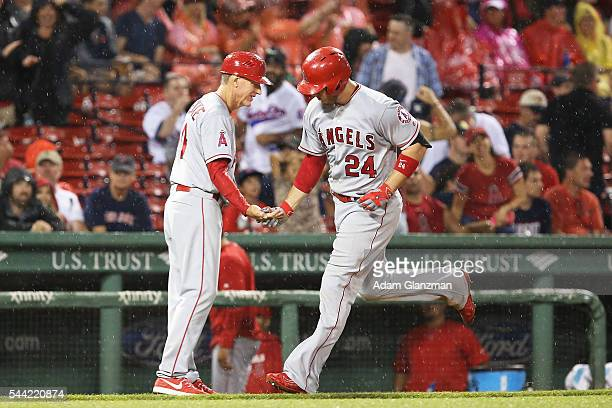 J Cron of the Los Angeles Angels of Anaheim rounds the bases after hitting a grand slam in the sixth inning during the game against the Boston Red...