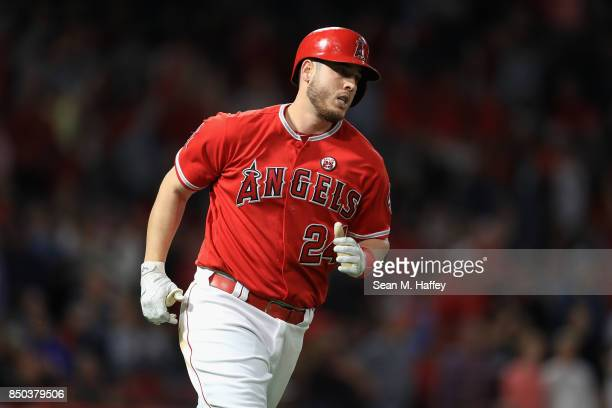 J Cron of the Los Angeles Angels of Anaheim runs to first base after hitting a solo homerun during the fifth inning of a game against the Cleveland...