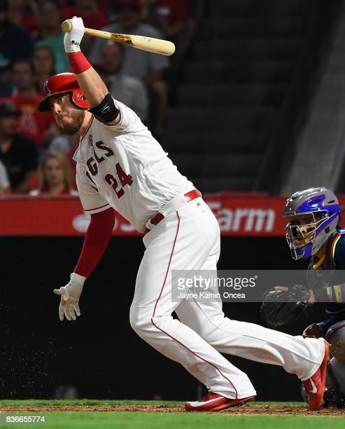 J Cron of the Los Angeles Angels of Anaheim singles in a run in the sixth inning of the game against the Texas Rangers at Angel Stadium of Anaheim on...