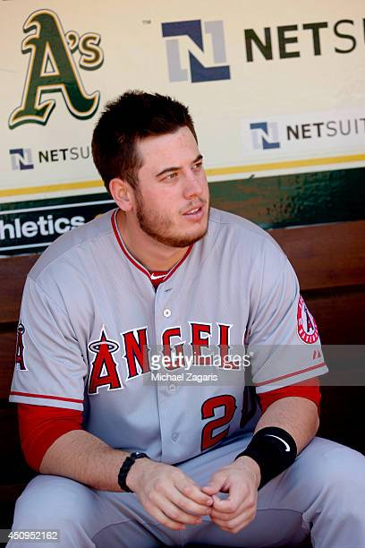 J Cron of the Los Angeles Angels of Anaheim sits in the dugout prior to the game against the Oakland Athletics at Oco Coliseum on June 1 2014 in...