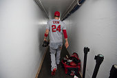 J Cron of the Los Angeles Angels of Anaheim walks down the clubhouse tunnel after defeating the Boston Red Sox 212 in the game at Fenway Park on July...