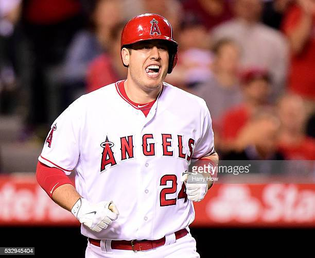 J Cron of the Los Angeles Angels reacts after he is hit by a pitch to score a run during the fifth inning against the Los Angeles Dodgers at Angel...