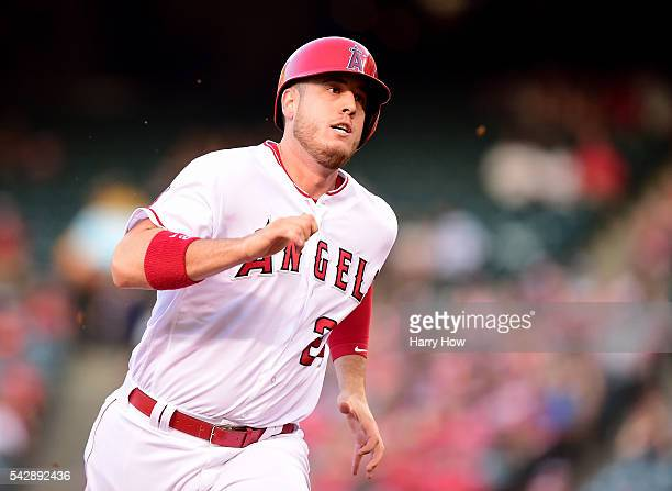 J Cron of the Los Angeles Angels takes a third base on a single from Jefry Marte during the first inning against the Oakland Athletics at Angel...