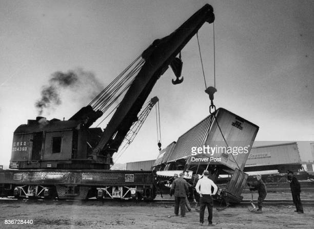 Crone Helps to Upright Derailed Freight Huge derrick at left lifts one of six Burlington cars which were derailed about 2 pm Saturday in the line's...