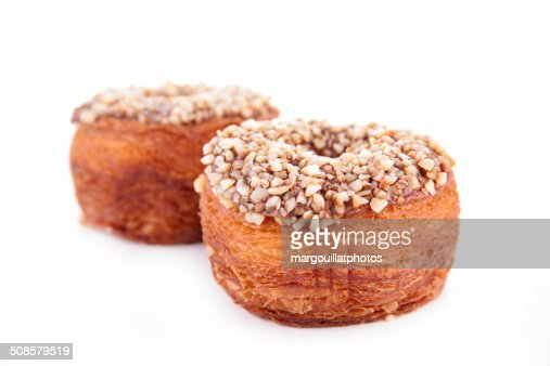 cronuts, puff pastry with nuts and chocolate : Stock Photo