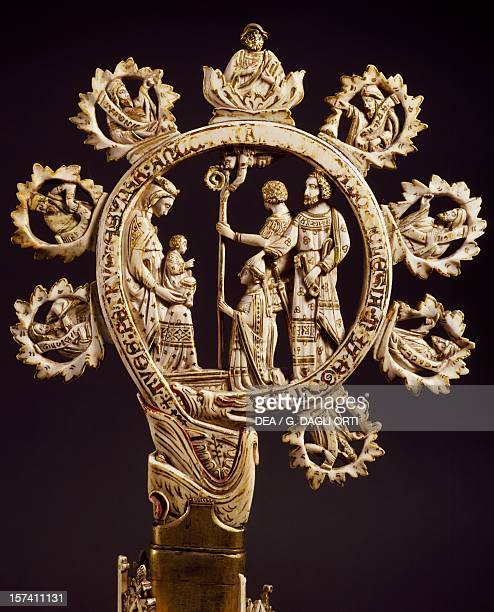 Crook from a crosier with the Madonna and Child being adored by a bishop artist from a Venetian School ivory Italy 14th century Florence Museo...