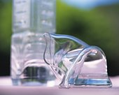 Crooked glass and plastic bottle