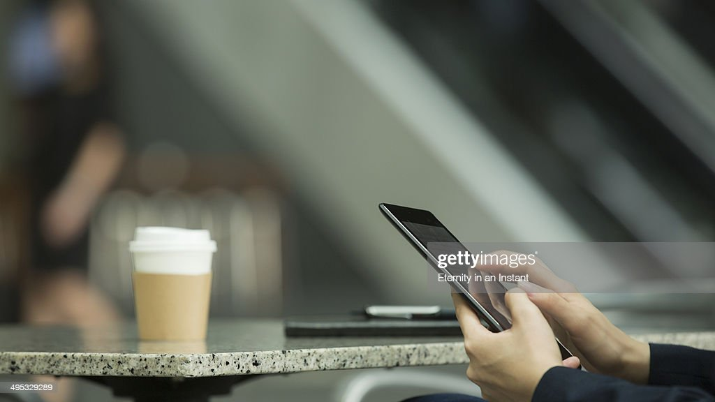 Crop of woman's hands working on a tablet