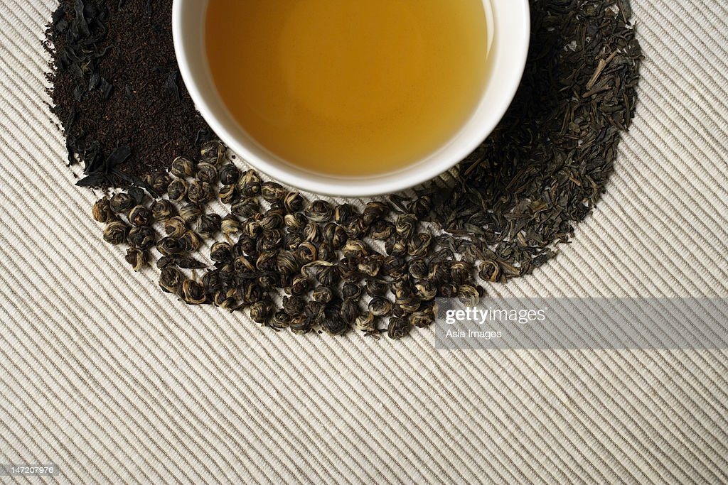 Crop shot of Green tea and leaves. : Stock Photo
