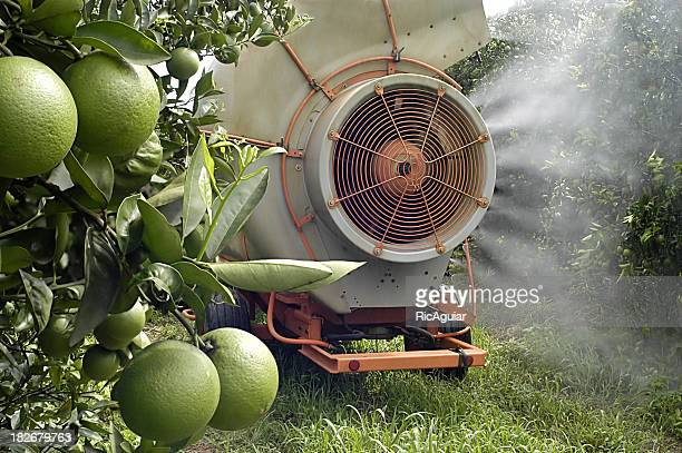 A crop sprayer on some fruit trees