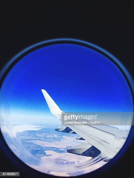 Cropped Airplanes Seen Through Circle Shaped Window