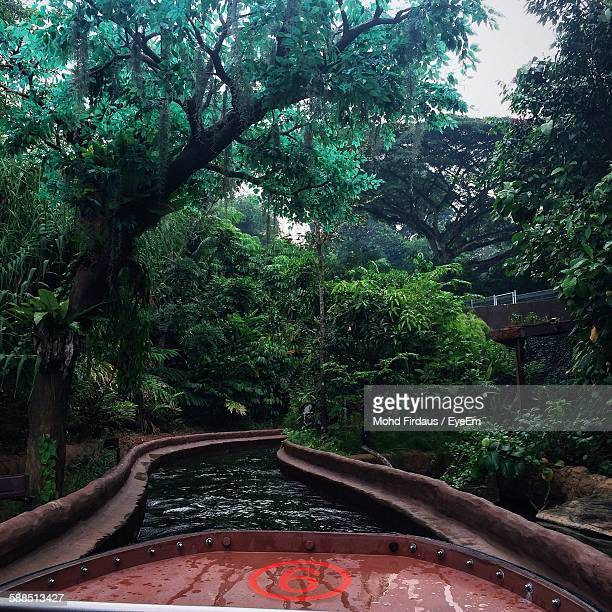 Cropped Boat On River Amidst Forest During Rainfall