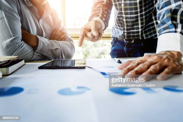 Cropped Business People Planning Strategy At Table In Office