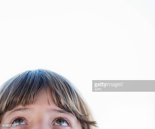 Cropped close up portrait of girl looking upward