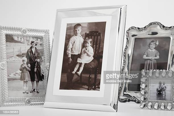 cropped group of framed vintage family photographs