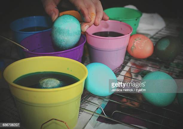 Cropped Hand Coloring Easter Eggs