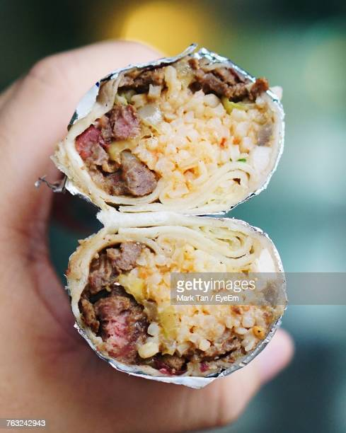 Cropped Hand Holding Burrito