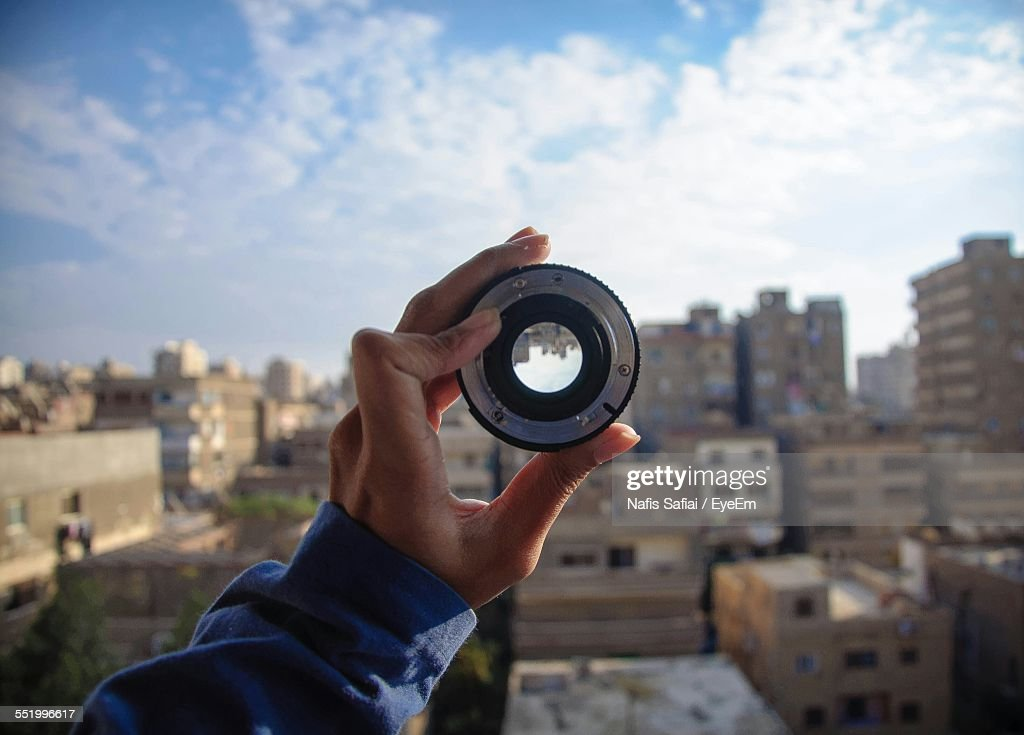 Cropped Hand Holding Camera Lens : Stock Photo